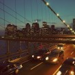 New York by night from the Brooklyn Bridge - Stock Photo