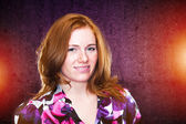 Cute Redhead Girl in a Grunge Colorful Background — Stock Photo
