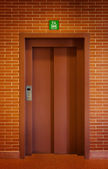 Elevator Door in a Brick Wall — Fotografia Stock