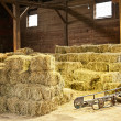 Interior of barn with hay bales - Stock Photo