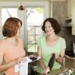 Stock Photo: Women doing dishes in kitchen