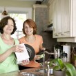 Women doing dishes in kitchen — Stock Photo #11552026