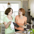 Women doing dishes in kitchen — Stock Photo