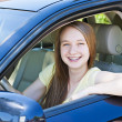 Teenage girl learning to drive — Stock Photo