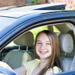 Teenage girl learning to drive - Stock Photo