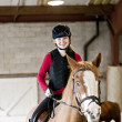 Teen girl riding horse — Stock Photo #11552102
