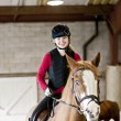Teen girl riding horse - Stock Photo