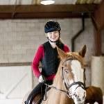 Teen girl riding horse — Stock Photo