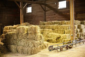 Interior of barn with hay bales — 图库照片