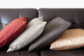 Cushions on leather sofa — Stock Photo