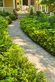 Stone path in landscaped home garden — Stock Photo