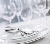Plates and cutlery — Stock Photo
