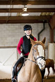 Teen girl riding horse — Stock Photo
