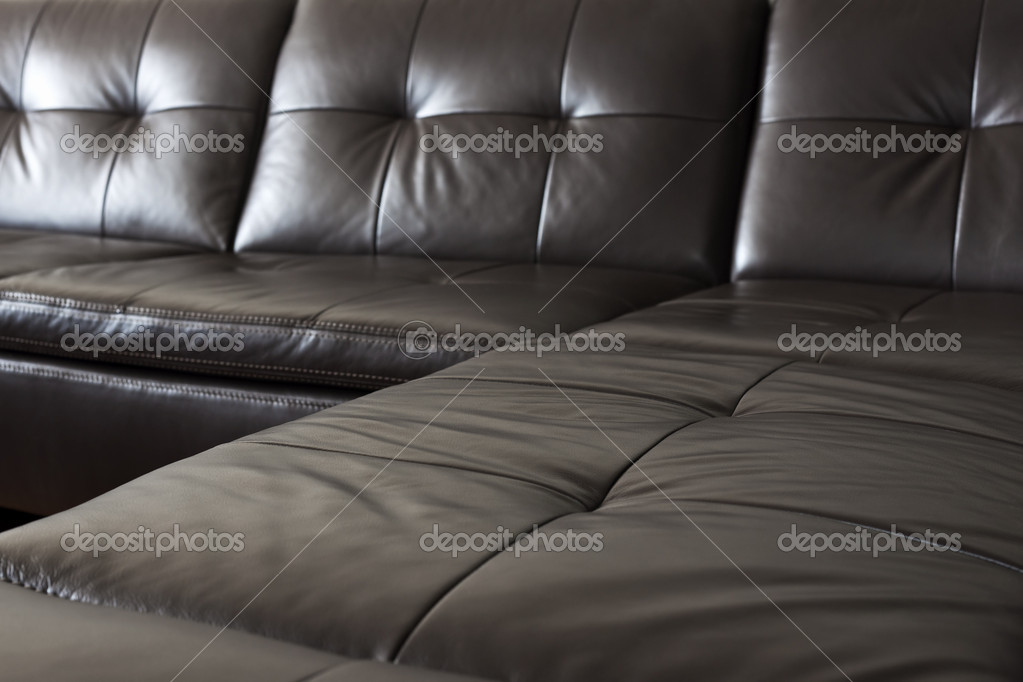 Closeup of luxurious expensive black leather couch — Stock Photo #11551169