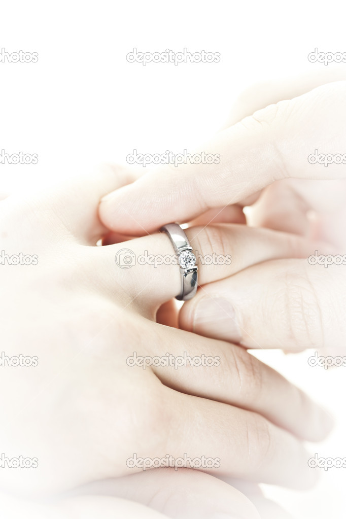 Closeup of hands placing engagement ring on finger — Stock Photo #11551334