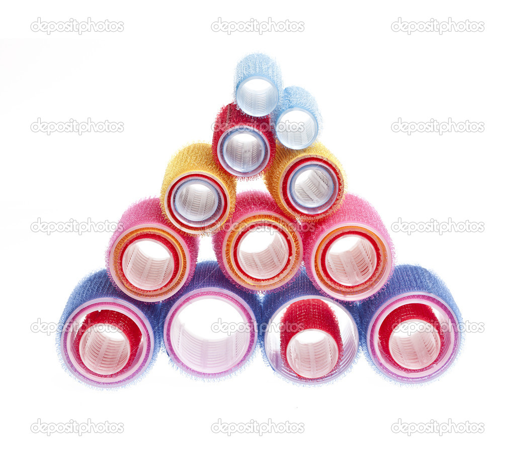 Colorful hair rollers stacked in pyramid isolated on white background  Stock Photo #11551338