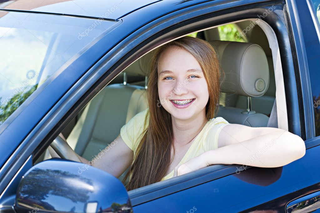 Teenage female driving student learning to drive a car — Stock Photo #11552086