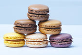 Lot of milticolored french macaroons, close-up — Stock Photo