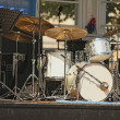 Drumset with nobody on stage, outdoors, isolated - Stock Photo