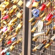 Bridge of love, locks locked onto a bridge — Stock Photo
