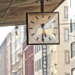 Street clock. Hanging clock on city walk. — Stock Photo