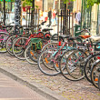 Bikes parked in the city, in a nice line into a rack — Stock Photo #11646860