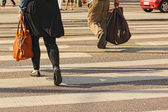 Walkers are crossing a town street, no faces — Stock Photo