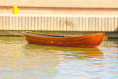 A wooden rowing boat tide down at harbor — Stock Photo
