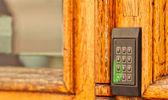 Old wooden door, with modern code opener — Stock Photo