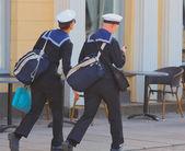 Couple of Finish navy sailors, walking on sidewalk, in Finland — Stock Photo