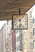 Street clock. Hanging clock on city walk. — Stock Photo