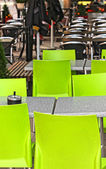 Restaurant outdoors with green chairs, nobody around — Stock Photo