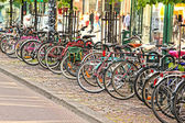 Bikes parked in the city, in a nice line into a rack — Stock Photo