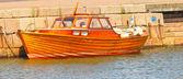Shiny wooden boat, mooring in water at harbor — Stockfoto