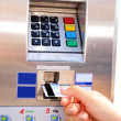 Person inserting, removing a card from ticket vending machine - Stock Photo