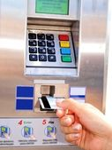 Person inserting, removing a card from ticket vending machine — Stock Photo
