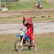 Motocross racer greets spectators — Stock Photo #12095145