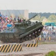 BMP-3 jumps from the ramp - Stock Photo