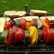 Foto Stock: Grilled vegetables skewers and roasted bread