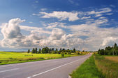 Rural road on sunny summer day — Stock Photo