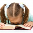 Little girl is sleeping on a book — Stock Photo #10775526