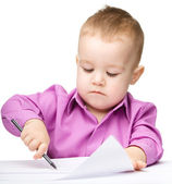 Cute little boy is drawing with pen — Stock Photo