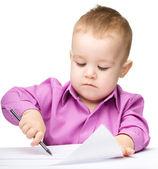 Cute little boy is drawing with pen — Foto Stock