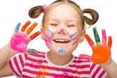 Portrait of a cheerful girl with painted hands — Stockfoto