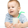 Cute little boy with a glass of milk — Stock Photo #10942353