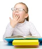 Cute little girl reading book — Stock Photo