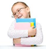 Cute dziewczynka z książki — Zdjęcie stockowe