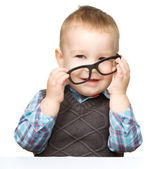 Portrait of a cute little boy wearing glasses — Stok fotoğraf