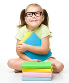 Cute little girl with books — Stok fotoğraf