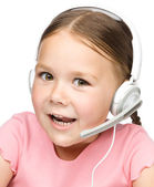Cute little girl is talking to customers — Stock Photo